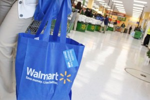 File photo of a shopper carrying her purchases from a newly opened Walmart Neighborhood Market in Chicago